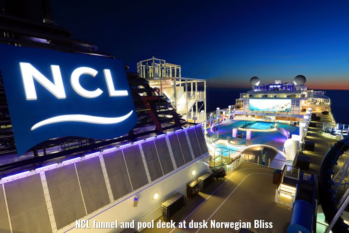 NCL funnel and pool deck at dusk Norwegian Bliss